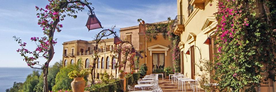 в атмосфере сада этого отеля 5 звезд в Таормине хочется находиться вечно