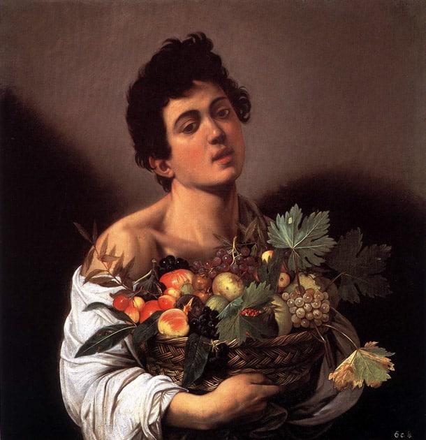 Юноша с корзинкой фруктов